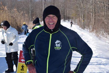Snowshoers run through Summerstown Trails