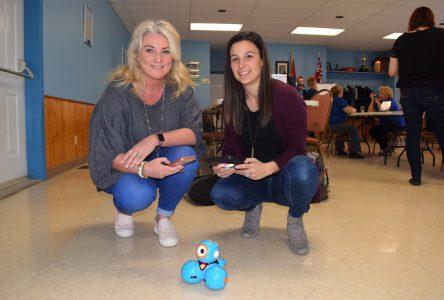Optimist Club helps teachers learn with robots