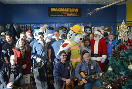 Sparky's crew serenades Toy Drive supporters