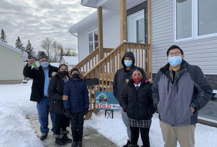 Habitat for Humanity hands keys to Ortiz family