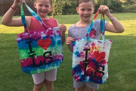 Tie-dying tote bags for some summer fun