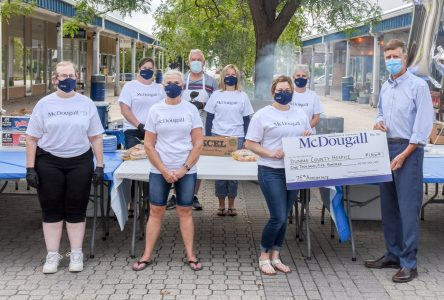 Celebrating 75 years of McDougall Insurance with a donation to DCH